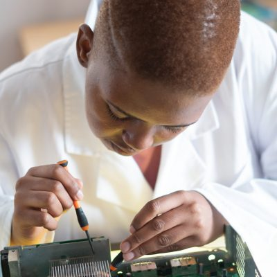 african-american-engineer-conducting-hardware-diagnostic-in-3825580